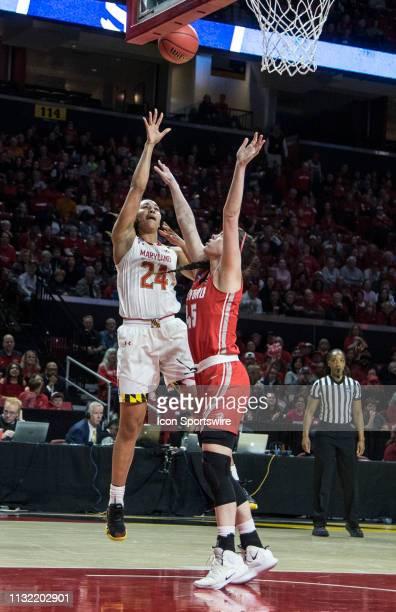 Maryland Terrapins forward Stephanie Jones sails in a shot over Radford Highlanders forward Savannah Felgemacher during a NCAA Div. 1 women's...