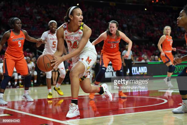 Maryland Terrapins forward Stephanie Jones saves the ball from going out during the fourth quarter in a women's basketball game between Illinois and...