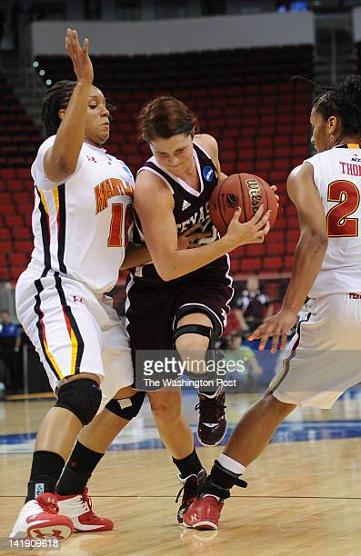 Maryland Terrapins guard Anjale Barrett left and Maryland Terrapins forward Alyssa Thomas right pressure Texas AampM Aggies guard Alexia Standish...