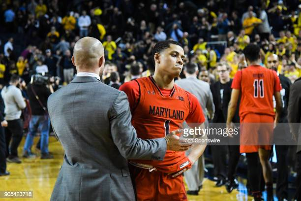 Maryland Terrapins guard Anthony Cowan is dejected following his teams 6867 last second loss during the Michigan Wolverines game versus the Maryland...