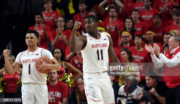 Maryland Terrapins guard Anthony Cowan Jr and Maryland Terrapins guard Darryl Morsell celebrate a call in the Terrapin favor during the second half...