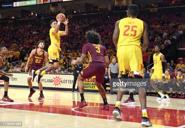 Maryland Terrapins guard Anthony Cowan Jr scores in the first half against Minnesota Golden Gophers forward Jordan Murphy on March 8 at Xfinity...