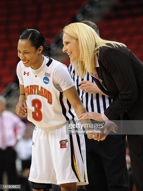 Maryland Terrapins guard Brene Moseley talks with Maryland Terrapins head coach Brenda Frese after Maryland builds up a lead late in the game during...
