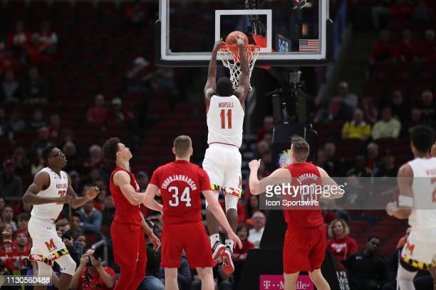 Maryland Terrapins guard Darryl Morsell dunks the ball in action during a Big Ten Tournament game between the Nebraska Cornhuskers and the Maryland...