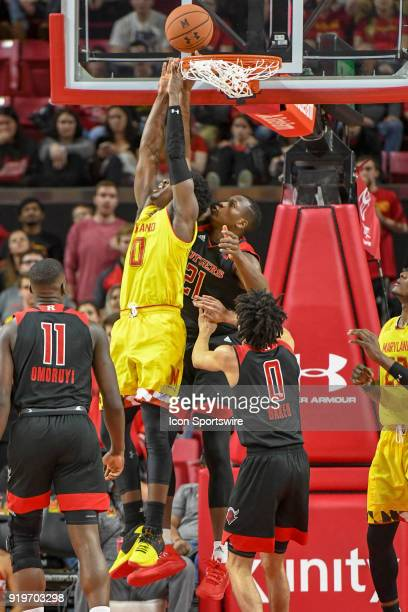 Maryland Terrapins guard Darryl Morsell scores in the first half over Rutgers Scarlet Knights forward Mamadou Doucoure on February 17 at Xfinity...