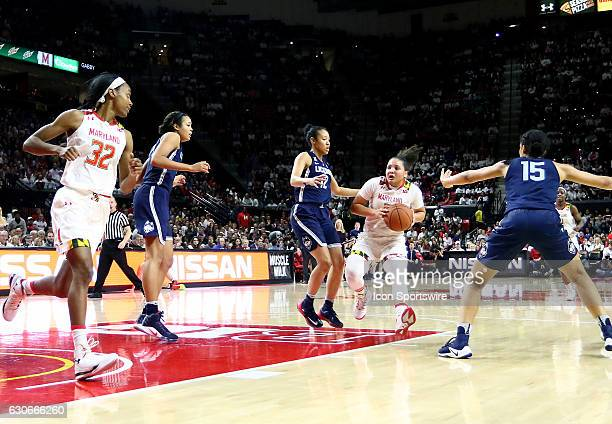 Maryland Terrapins guard Destiny Slocum moves between Connecticut Huskies guard Saniya Chong and guard Gabby Williams during a NCAA women's...