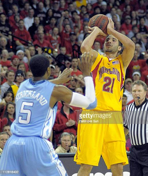 Maryland Terrapins guard Greivis Vasquez drains a threepointer above North Carolina Tar Heels guard Dexter Strickland during the second half in...