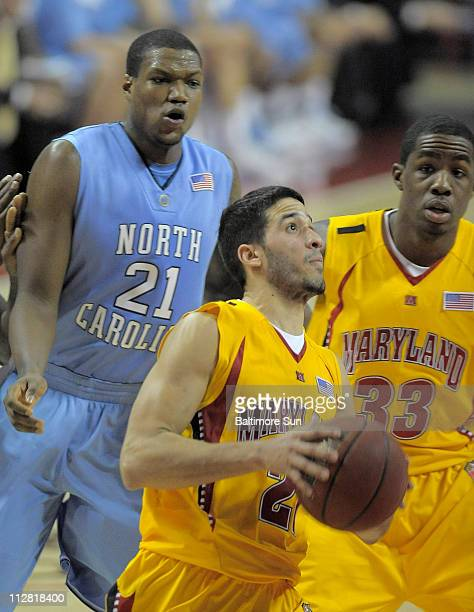 Maryland Terrapins guard Greivis Vasquez drives past North Carolina Tar Heels forward Deon Thompson for two of his 26 points during the second half...