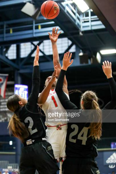Maryland Terrapins guard Ieshia Small shoots as Akron Zips guard Destiny Perkins and Akron Zips forward Caitlin Vari defend during the third quarter...