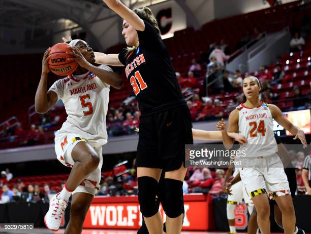 Maryland Terrapins guard Kaila Charles goes up against Princeton Tigers guard/forward Bella Alarie in the first half of NCAA tournament first round...
