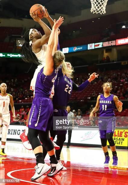 Maryland Terrapins guard Kaila Charles shoots over Niagara Purple Eagles forward Kaylee Stroemple and forward Victoria Rampado during a women's...