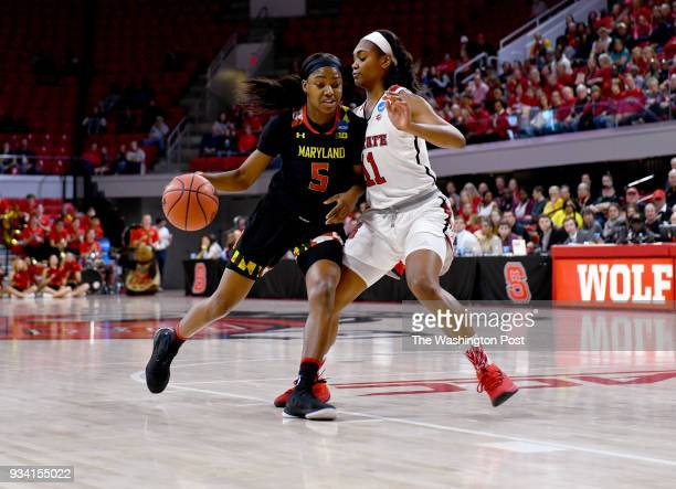 Maryland Terrapins guard Kaila Charles tries to get past North Carolina State Wolfpack Kiara Leslie a former Terp in the first half of the NCAA...