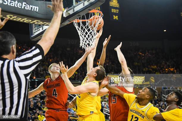Maryland Terrapins guard Kevin Huerter goes in for a layup and has it blocked by Michigan Wolverines guard Duncan Robinson during the Michigan...