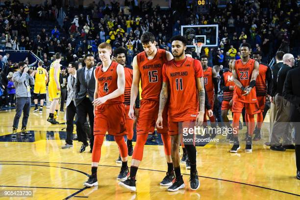 Maryland Terrapins guard Kevin Huerter Maryland Terrapins center Michal Cekovsky and Maryland Terrapins guard Jared Nickens walk off the court...