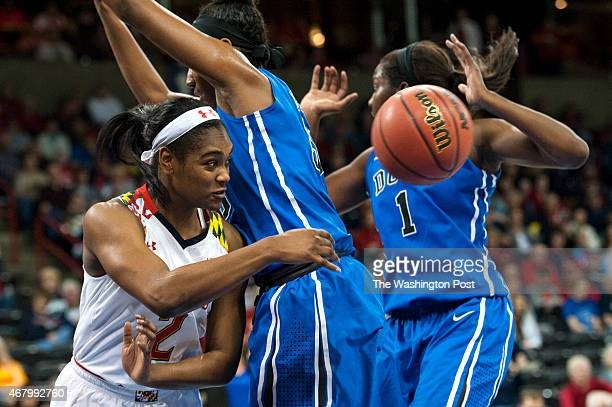 Maryland Terrapins guard Kiara Leslie passes around the Duke Blue Devils defense in the first half at Spokane Veterans Memorial Arena during the NCAA...