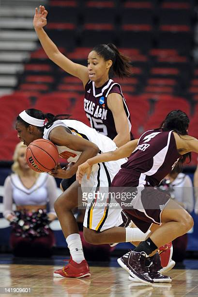 Maryland Terrapins guard Laurin Mincy almost looses the ball as Texas AampM Aggies guard Skylar Collins top and Texas AampM Aggies guard Sydney...