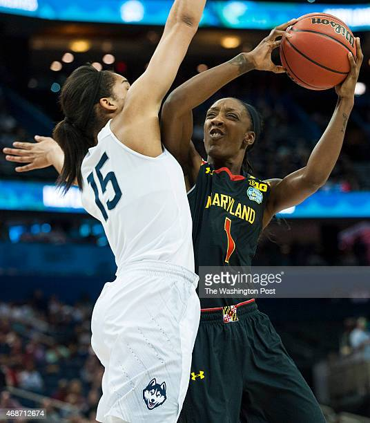 Maryland Terrapins guard Laurin Mincy tries to shoot around Connecticut Huskies guard Gabby Williams in the second half of the NCAA women's final...