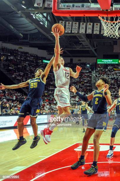 Maryland Terrapins guard Reese Mona scores in the second half against Michigan Wolverines guard Eli Brooks on February 24 at Xfinity Center in...