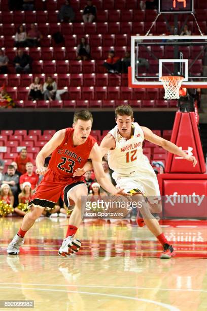 Maryland Terrapins guard Reese Mona steals the ball from Catholic Cardinals forward Jimmy Golaszewski on December 12 at Xfinity Center in College...