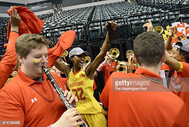 Maryland Terrapins guard Shatori WalkerKimbrough and Maryland Terrapins guard Brene Moseley join the band in a celebration after they won backtoback...