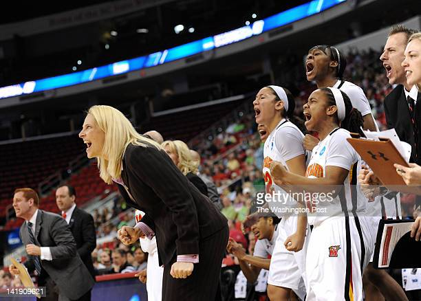 Maryland Terrapins head coach Brenda Frese and the Maryland Terrapins bench cheer after a Maryland basket late in the game during a Regional...