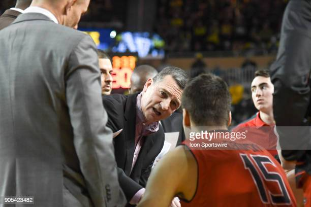 Maryland Terrapins head coach Mark Turgeon gives instruction to Maryland Terrapins center Michal Cekovsky during a timeout during the Michigan...