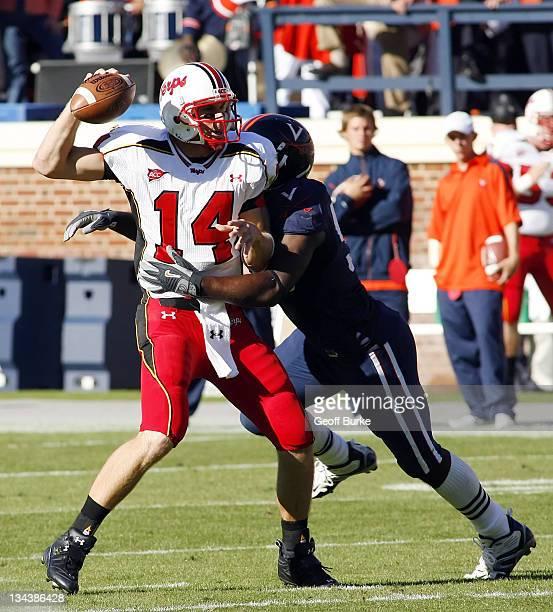 Maryland Terrapins quarterback Sam Hollenbach throws under pressure from a Virginia defender at Scott Stadium, Charlottesville, Vriginia, October 14,...