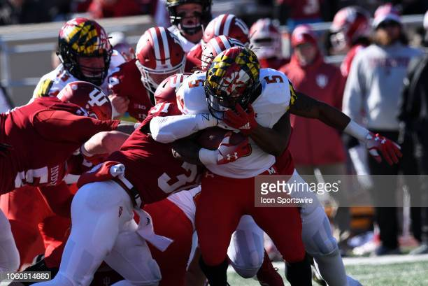 Maryland Terrapins running back Anthony McFarland is wrapped up by Indiana Hoosiers defensive back Bryant Fitzgerald and Indiana Hoosiers defensive...