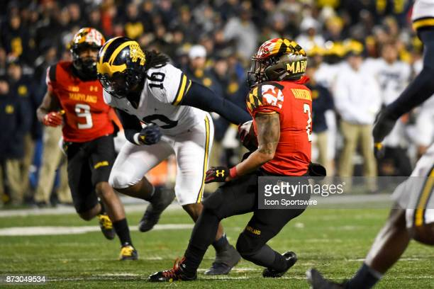 Maryland Terrapins running back Lorenzo Harrison III makes a pass reception in the third quarter against Michigan Wolverines linebacker Devin Bush on...
