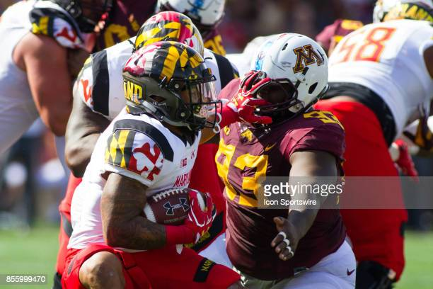 Maryland Terrapins running back Lorenzo Harrison III stiff arms Minnesota Golden Gophers defensive lineman Merrick Jackson during the Big Ten...