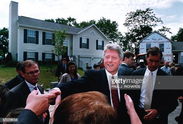 Maryland US President Bill Clinton presses the flesh 03 Jun during a short visit to a group of twostory homes being built for firsttime homebuyers In...