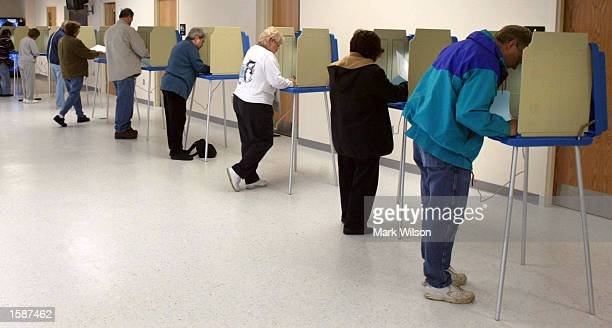 Maryland voters stand at voting booths at Dunkirk Fire House November 5 2002 in Dunkirk Maryland Democrat Lt Governor Kathleen Kennedy Townsend is...