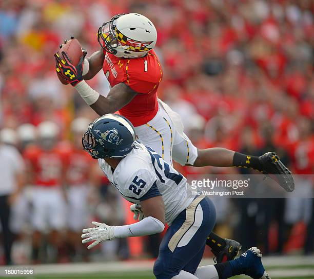 Maryland wide receiver Stefon Diggs top grabs a long 1st quarter pass over Old Dominion safety Andre Simmons near the goal line to set up a TD as the...