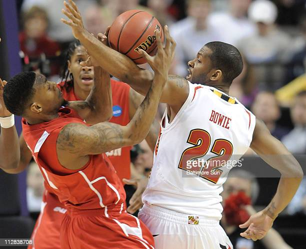 Maryland's Adrian Bowie battles with Houston's Aubrey Coleman for a rebound during the second half of a first round of the NCAA Men's Basketball...