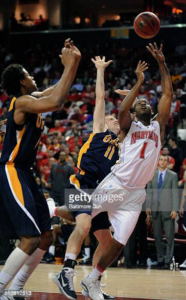 Maryland's Adrian Bowie is fouled by UNC Greensboro's Korey Van Dussen in the first half at Comcast Center in College Park Maryland on Wednesday...