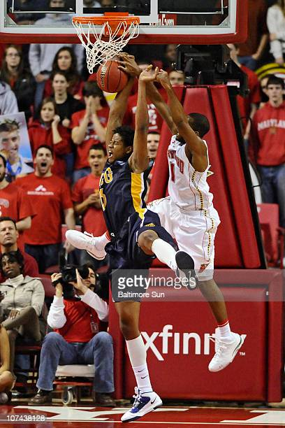 Maryland's Adrian Bowie right came from behind the block a shot by UNC Greensboro's Haukur Palsson in the second half at Comcast Center in College...