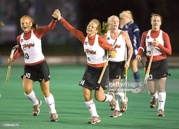 Maryland's Ameliet Rischen receives a high five from her sister Berber Rischen after scoring the tying goal versus Connecticut in the 2006 NCAA...
