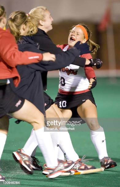 Maryland's Berber Rischen is mobbed by her teammates after her penalty stroke sealed their win over Connecticut in the 2006 NCAA Division I Field...