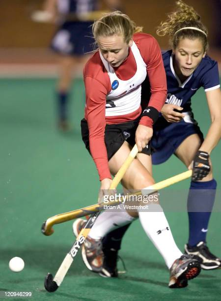 Maryland's Bri Davies is defended by Connecticut's Lindsey Leck during the 2006 NCAA Division I Field Hockey Final Four semi-finals at Kentner...