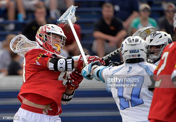 Maryland's Connor Kelly shoots between North Carolina players in the second half in the NCAA quarterfinal game at Navy Marine Corps Memorial Stadium...