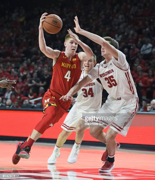 Maryland's Kevin Huerter left drives to the basket against Wisconsin's Brad Davison and Nate Reuvers in the first half on Sunday Feb 4 2018 at...