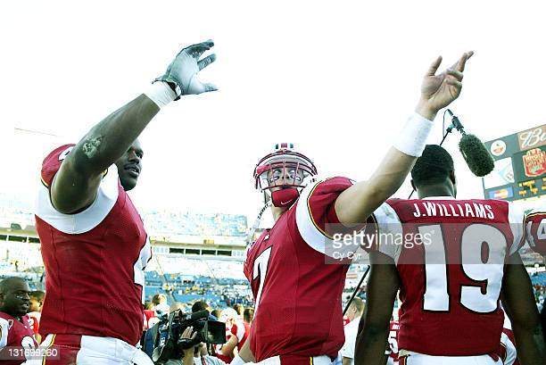 Maryland's Latrez Harrison left and Scott McBrien center wave to fans with seconds remaining in the 2004 Gator Bowl at Alltel Stadium on January 1st...