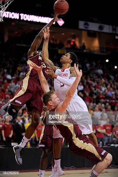 Maryland's Nick Faust cannot get his shot past Denver defenders Chris Udofia and Chase Hallam during firsthalf action in the NIT basketball...