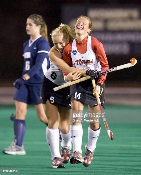 Maryland's Susie Rowe hugs teammate Ameliet Rischen after Rischen scored the tying goal versus Connecticut during first half action of the 2006 NCAA...