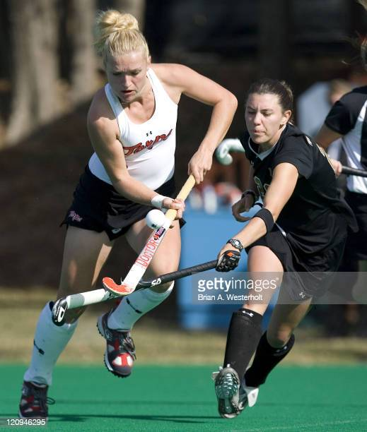 Maryland's Susie Rowe tries to control the ball while being pursued by Wake Forest's Michele Kasold during second half action at the 2006 ACC Field...