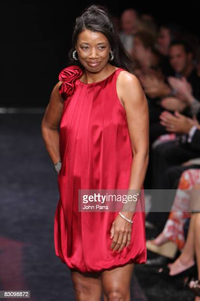 Maryline Blackburn walks the runway at the Red Dress Show for the American Heart Association during Funkshion Fashion Week at Miami Beach Botanical...