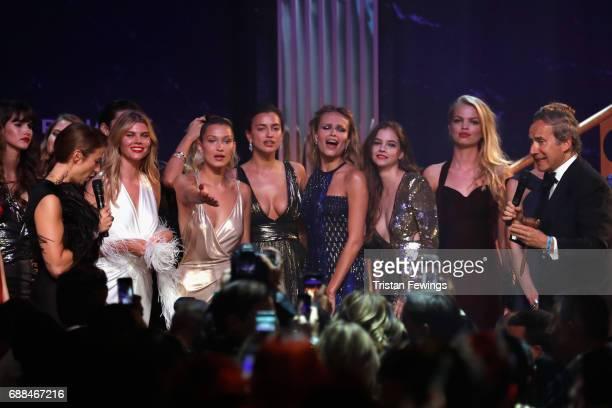 Maryna Linchuk Bella Hadid Irina Shayk Natasha Poly Barbara Palvin Daphne Groeneveld and Simon de Pury are seen on stage at the amfAR Gala Cannes...