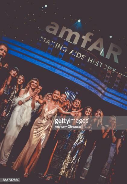 Maryna Linchuk Bella Hadid Irina Shayk Natasha Poly Barbara Palvin and Daphne Groeneveld are seen on stage at the amfAR Gala Cannes 2017 at Hotel du...