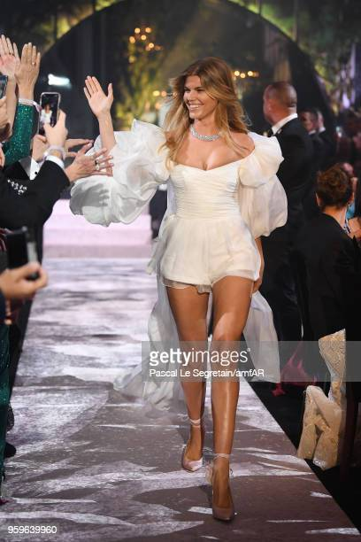 Maryna Linchuk wearing Yanina Couture walks the runway at the amfAR Gala Cannes 2018 at Hotel du CapEdenRoc on May 17 2018 in Cap d'Antibes France