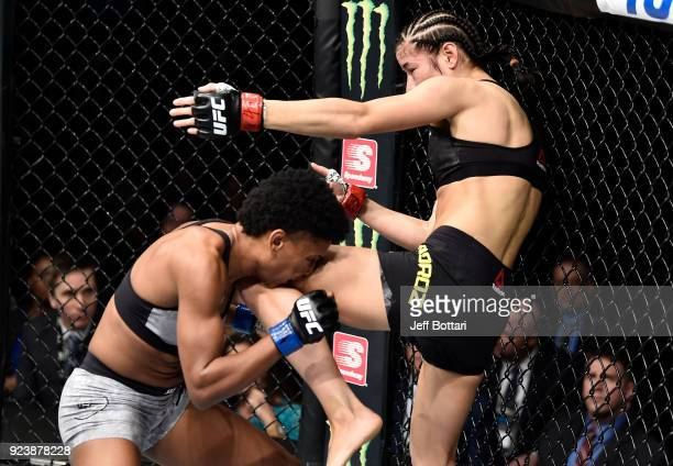 Maryna Moroz of Ukraine knees Angela Hill in their women's strawweight bout during the UFC Fight Night event at Amway Center on February 24 2018 in...
